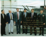 Signed photo with Senator Helms and members of the North Carolina Army National Guard